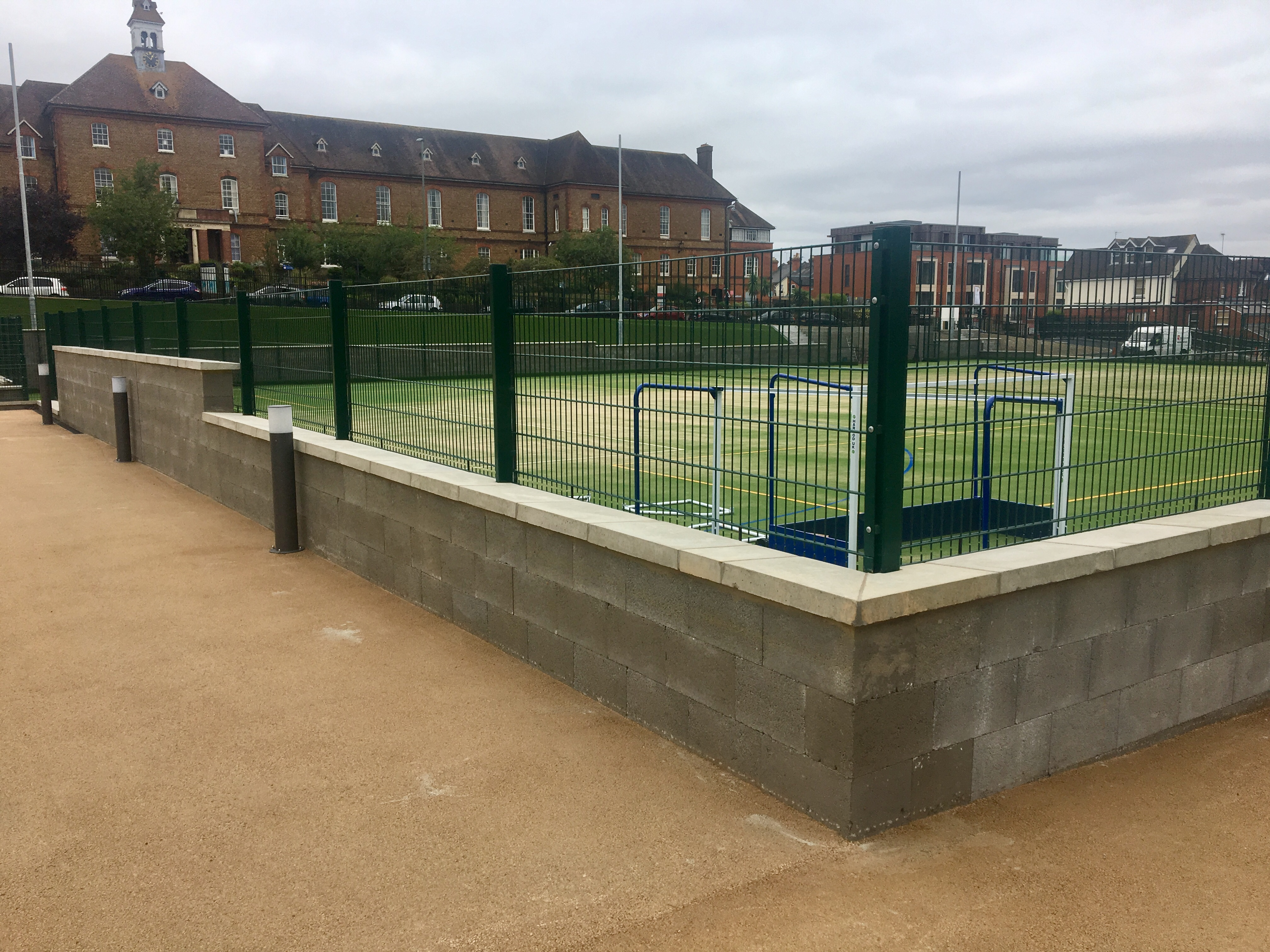 Concrete Retaining Wall Surrounding Tennis Court